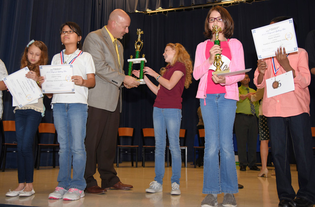Sarah Flannery accepts her trophy from Superintendent Jacob Oliva. (Jason Wheeler, Flagler Schools)