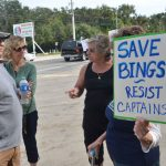 Captain's co-owner Chris Herrera, left, speaking with protesters in November 2018, days after the county commission had approved a lease agreement with the restaurant, and days before it would reconsider it. (© FlaglerLive)