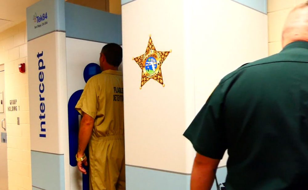 The body scanner in action at the Flagler County jail, from a video still.
