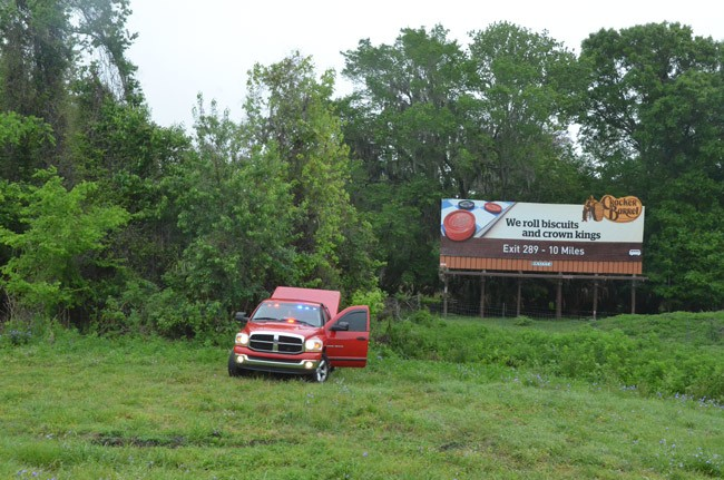 Police were investigating the scene of this morning wreck in a wooded ditch off I-95. (© FlaglerLive)