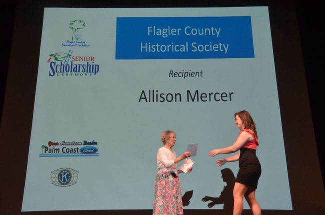 Handing out a scholarship in 2012. (© FlaglerLive)