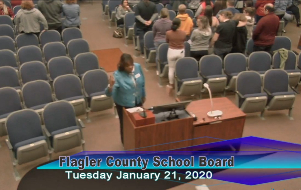 Many in the school board chamber turned their back on Charlene Cothran as the pastor again attacked a transgender student and LGBTQ rights at a meeting of the board Tuesday evening.