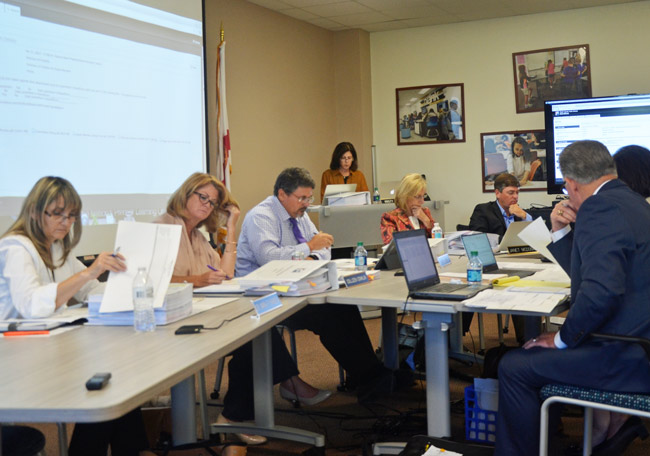 Flagler County School Board members this afternoon choosing the candidates they'll interview on April 20. (© FlaglerLive)