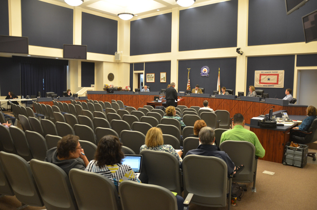 Despite the number of programs on the line for elimination, the school board's meeting room was largely empty as board members went down their list of cuts. (c FlaglerLive)
