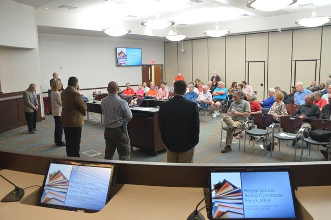 The first forum of the election season was hosted by the Republican Club of Flagler County and was held at City Hall in Palm Coast. The five school board candidates lined up for introductions before taking questions from the dais. (© FlaglerLive)