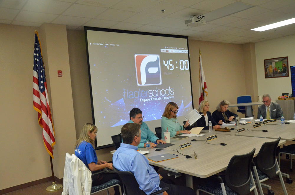 The Flagler County School Board preparing for a meeting last year. (© FlaglerLive)