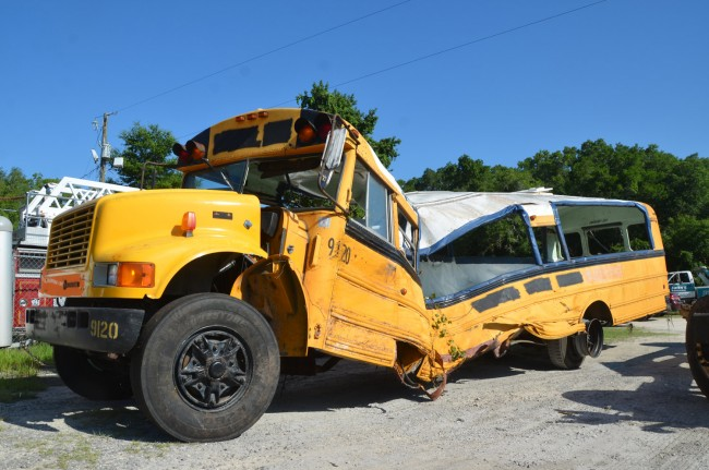 One of the less-damaged of the three school buses. Click on the image for larger view. (© FlaglerLive)
