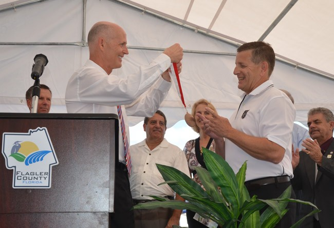 gov. rick scott aveo engineering flagler