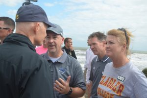 Gov. Rick Scott speaking eye-to-eye with, from left, Superintendent Jacob Oliva, Deputy Superintendent Vern Orndorff, and School Board Chairman Colleen Conklin this morning in Flagler Beach. Click on the image for larger view. (c FlaglerLive)