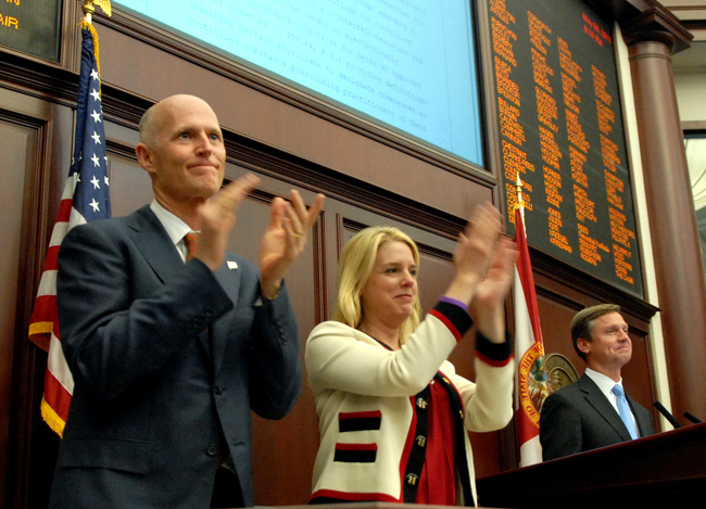He has reasons to applaud:  Florida Gov. Rick Scott with Attorney General Pam Bondi and House Speaker Dean Cannon, R-Winter Park, right, celebate unanimous approval of pill-mill legislation in the House late Friday, May 6. (Meredith Geddings)