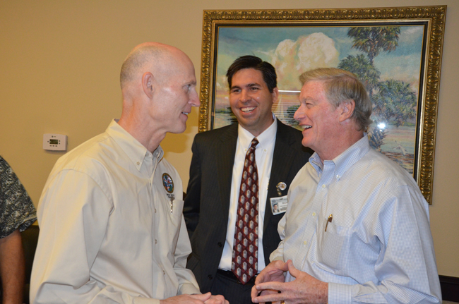 Gov. Rick Scott, during his last Flagler stop-over in August 2011, hobnobbing with Florida Hospital Flagler CEO David Ottati and Sen. John Thrasher. (c FlaglerLive)
