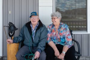 "Delmar Scroughams and his wife, Vergie ""Verg"" Scroughams, at home in Rexburg, Idaho. During a lucid moment in May, Delmar, who has dementia, acknowledged his weapons could prove dangerous."