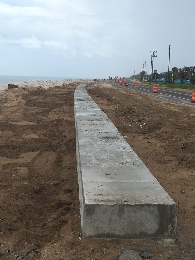 The sea wall is complete at the north end of Flagler Beach. It is to be buried under a wall of sand and plants. (© FlaglerLive)