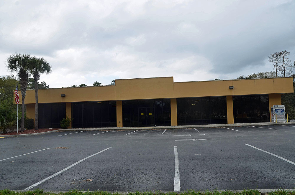 The beleaguered former Sears building off of Palm Coast Parkway, now part of the flock of county albatrosses. (© FlaglerLive)