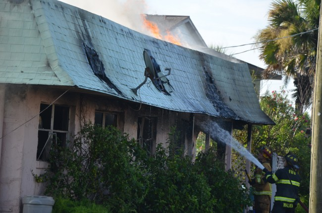 The fire was still burning some four hours after it had started. Click on the image for larger view. (© FlaglerLive)