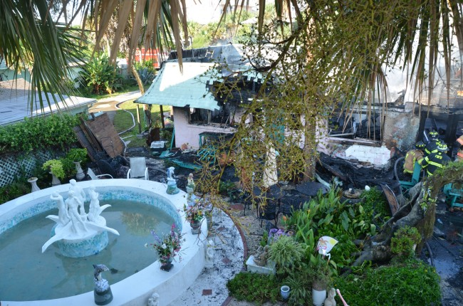 The business was flanked by a handsome courtyard and fountain. Click on the image for larger view. (© FlaglerLive)