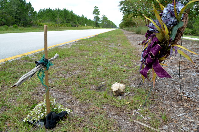 The small roadside memorial where Kirt Smith was struck, on Seminole Woods Boulevard. (© FlaglerLive)