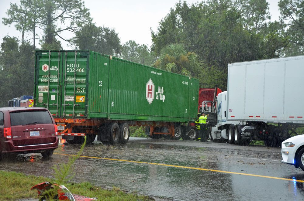 Two of the three semis involved in the crash on I-95 just after noon today, under heavy rain.  The crash shut down all southbound lanes. (© FlaglerLive)