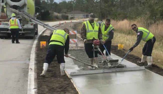 Palm Coast city crews poured concrete on a new pathway along Sesame Boulevard last week. (Palm Coast)