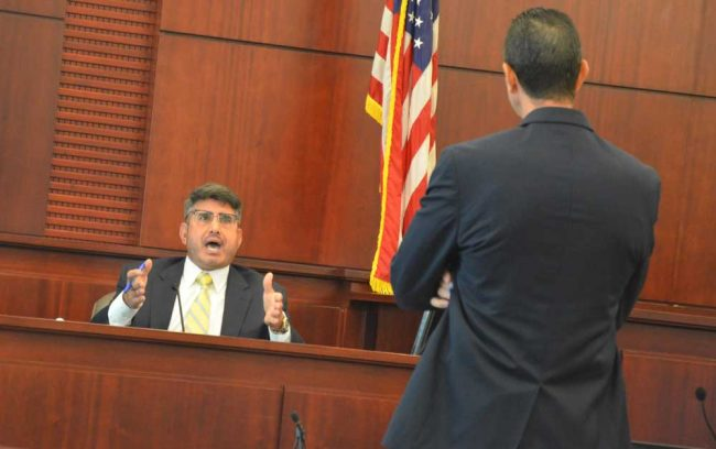 Jo Sesta during his encounter with Assistant State Attorney Jason Lewis today. (© FlaglerLive)