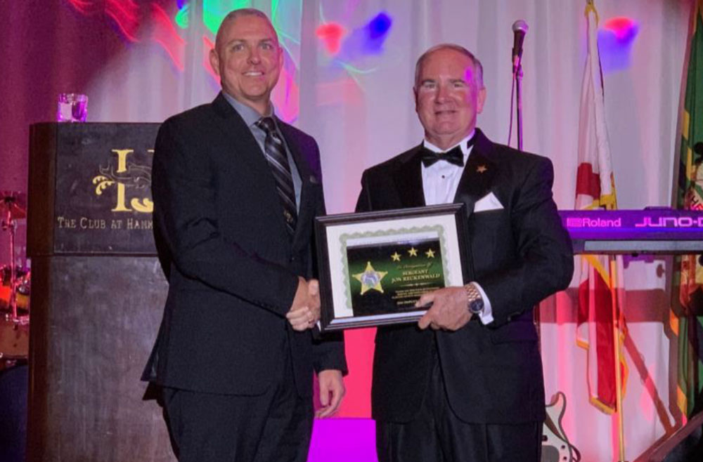 Sergeant Jon Reckenwald, the law enforcement deputy of the year, with Sheriff Rick Staly. (FCSO)