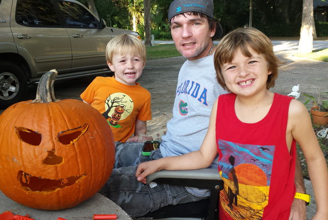 Shane Kitchens late last month, a few weeks after the accident on A1A that left him in a wheelchair, with his sons, Gavin, 7, and Kaine, 4. (Kitchens family)