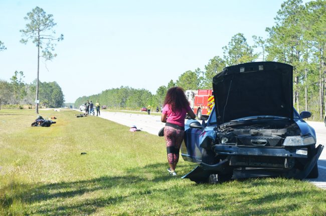 Daija Shavers stood by the car she'd driven through the bikers about an hour after the crash, the wreckage still untouched. Click on the image for larger view. (© FlaglerLive)