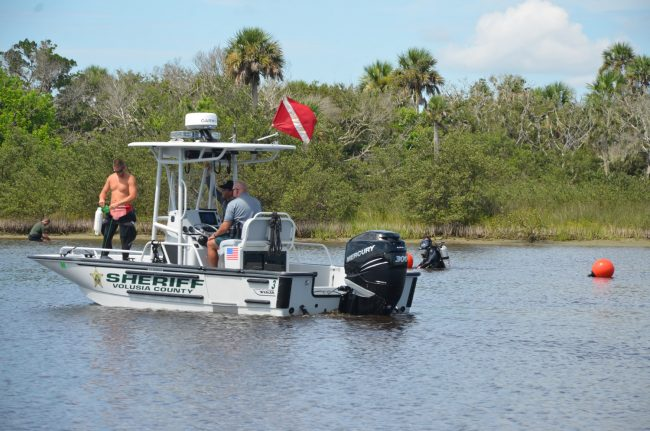 The Sheriff's Office, assisted by Volusia County Sheriff's units, sent in divers into the Intracoastal this morning. (c FlaglerLive)