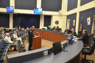The sheriff addressing the commission Monday, as Coffey listened in to Staly's left. (© FlaglerLive)