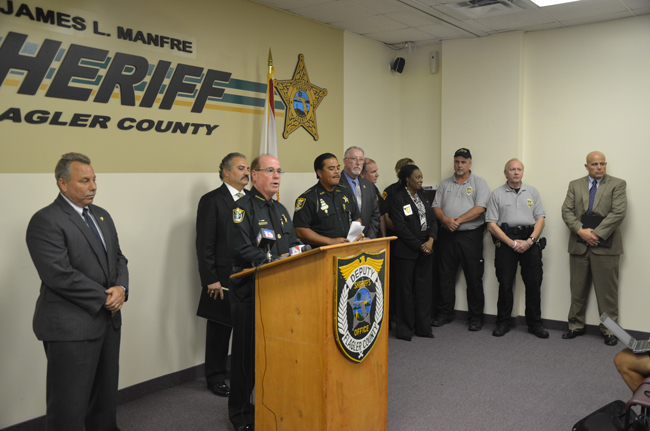 The usual suspects at today's press conference at the Flagler County Sheriff's Office, including R.J. Larizza and Sheriff Jim Manfre, at the podium. (© FlaglerLive)