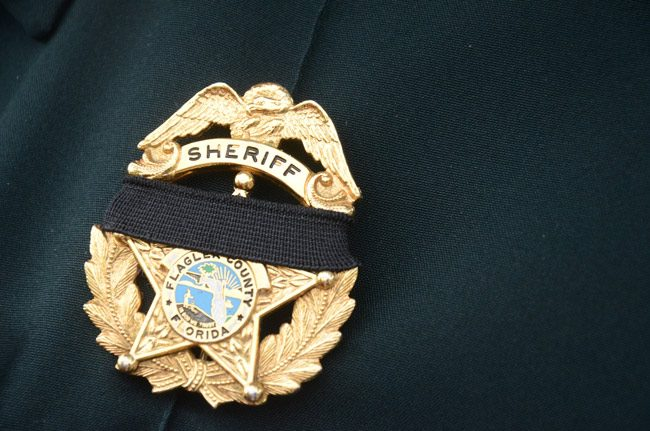 The Flagler County Sheriff holds its annual Law Enforcement Memorial ceremony, this year starting with a candlelight vigil at the Flagler County Courthouse, then walking to the Sheriff's Operations Center. See below. (© FlaglerLive)