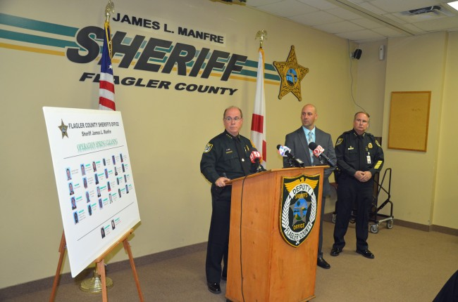 Sheriff Jim Manfre, with Lt. Chris Seppe and Undersheriff Rick Staly, speaking of 'Operation Spring Cleaning' at a lightly attended news conference Tuesday. Click on the image for larger view. (© FlaglerLive)