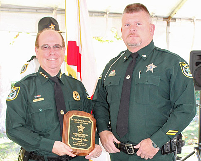 Flagler County Sheriff Jim Manfre presenting Randy Stephen Vickers with the Detention Deputy of the Year award last December. (FCSO)