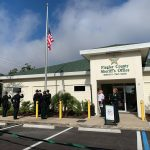 Sheriff Rick Staly, by the [podium, during the flag-raising in front of the Sheriff's Office's new Palm Coast Precinct this morning. (© FlaglerLive)