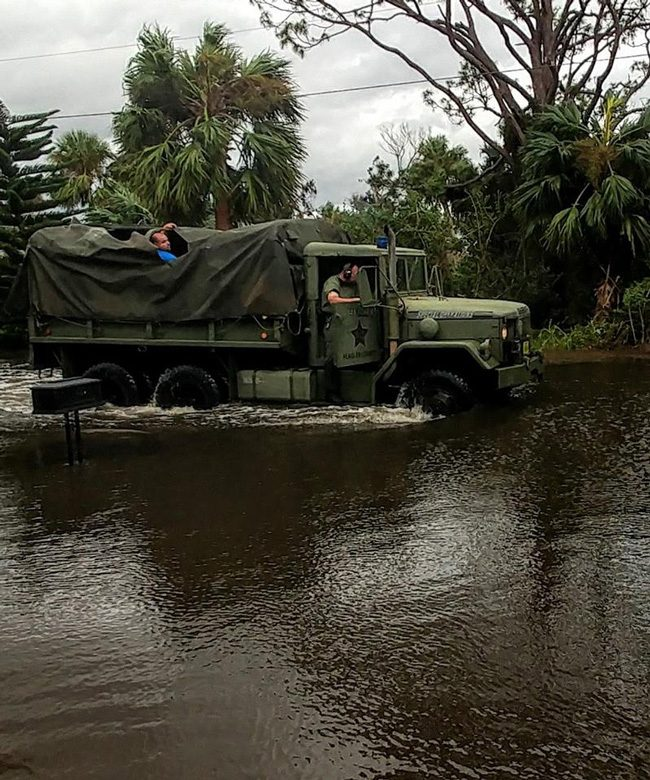 One of two 'Deuce and a half,' military surplus trucks the sheriff's office sent out this morning to Flagler Beach to check on stranded residents, an experience that made one resident's day--before he himself decided to do likewise, in a kayak. (Scott Spradley for FlaglerLive)