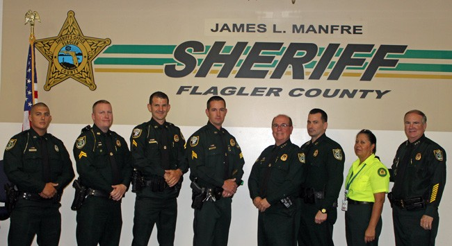 From left, Detention Deputy Ronald Ward, Sergeant Jonathan Welker, Corporal Ryan Emery, Sergeant Jason Neat, Sheriff James L. Manfre, Chief Deputy Jeff Hoffman, Joann Ramos and Undersheriff Rick Staly, who retires Friday.