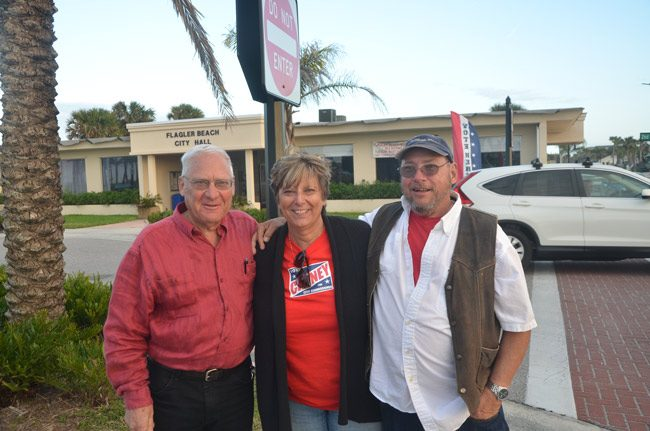 Flagler Beach Commissioners Marshall Shupe, left, and Kim Carney, with challenger Paul Eik, late this afternoon. (© FlaglerLive)
