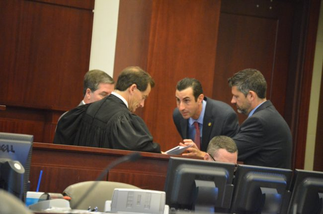 A sidebar between Judge Craig, Assistant State Attorneys Jason Lewis, Joe LeDonne, and Assistant Public Defender Bill Bookhammer. Click on the image for larger view. (© FlaglerLive)