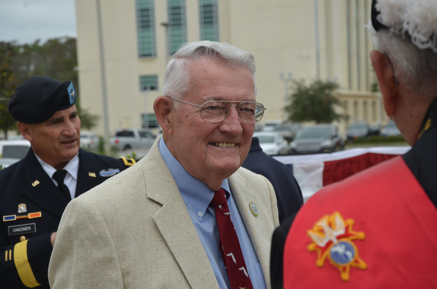 Sisco Deen, Flagler County's Veteran of the Year, served two decades in various branches of the military. His three sons have also served. In the background is Army National Guard Brigadier General Mike Canzoneri, who was today's keynote speaker. (© FlaglerLive)