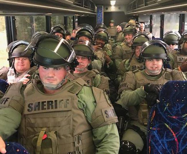 St. Johns County Sheriff's deputies in riot gear heading for Gainesville today. (SJSO)