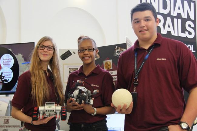 Samantha Lauria, 14, Rose Minaya, 13, and Justin Cestare, 14, were represented the Indian Trails Middle School robotics flagship program at last week's symposium. (© FlaglerLive).