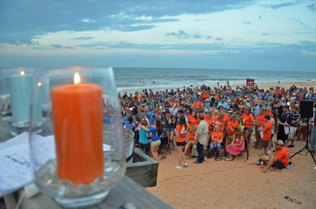 The orange candle was for Lane, the blue for Meredith: favorite colors of two teens remembered in a vigil in Flagler Beach this evening. Click on the image for larger view. (© FlaglerLive)