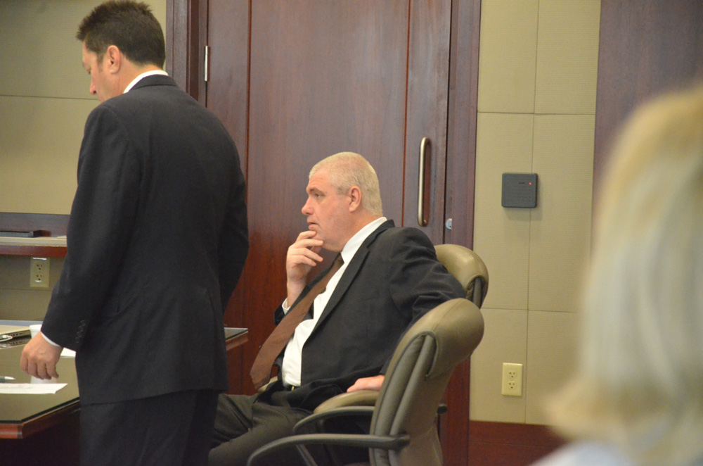 David Snelgrove this morning, before the verdict, with his attorney, Michael Nielsen. In the foreground to the right, the murder victim's daughter eyed Snelgrove, having attended all seven days of trial, just as she had all previous such trials over the years. (© FlaglerLive)