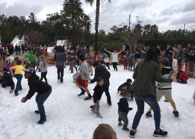 Snowfest 2018 took over Town Center in Palm Coast Saturday. The event was a fund-raiser for the Flagler County Rotary Club. (© FlaglerLive)