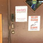The sign at the entrance to the Social Club of Palm Coast on Old Kings Road. It did not stop patrons from taking off their masks once inside and triggering superspreader events in late August. The club reopened on Monday after a hiatus for cleaning. (© FlaglerLive)