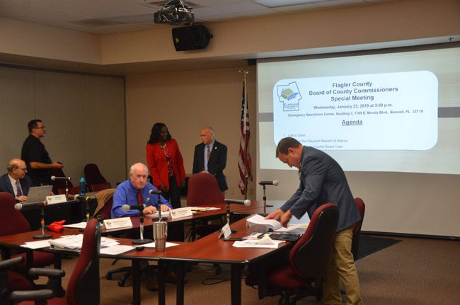 Only three commissioners showed up for today's special meeting: Commissioner Dave Sullivan and Joe Mullins, on either side of the table, and Commission Chairman Don O'Brien, speaking with Deputy County Administrator Sally Sherman. (© FlaglerLive)