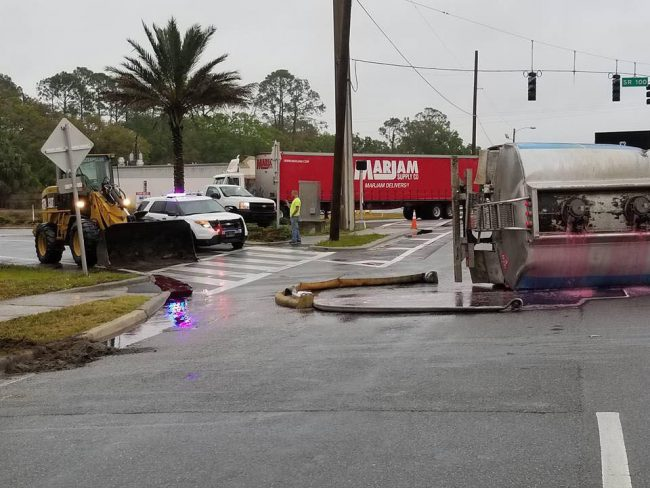 The pink diesel fuel went into a retention ditch and storm drains. Click on the image for larger view. (Flagler County Fire Rescue)