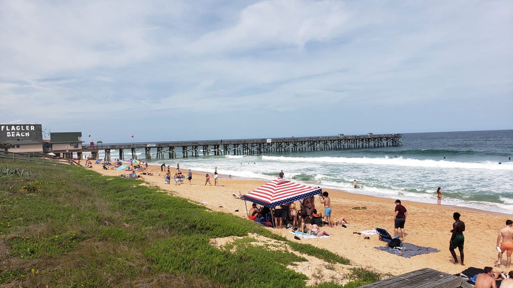 In Flagler Beach, it's spring break as usual, as was the case in midafternoon today, with mostly young people who are not mindful of virus concerns, according to Eric Cooley, the Flagler Beach city commissioner and owner of the 7-Eleven on the beach. He said he will bring up his concerns at a special meeting of the city commission this week, when the commission will declaring a local state of emergency. (© FlaglerLive)