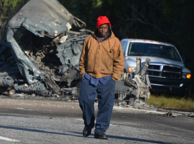 Albert Lee Anderson, a wrecker with Southern Crane and Wrecker service, at the scene. Anderson was mis-identified in a previous version of this story.  (© FlaglerLive)