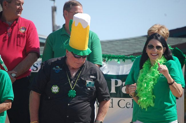 That was St. Patrick's Day: Then-Palm Coast Mayor John Netts and future Pal Coast Mayor Milissa Holland at a Flagler Beach celebration in 2011. (© FlaglerLive)